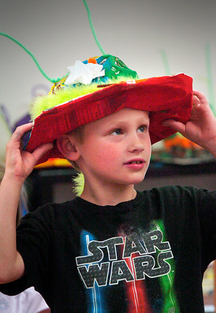 """BRYAN EATON/Staff Photo. Harrison Amaral, 7, tries on his just finished """"alien hat"""" in Alli Tanzella's second grade class at the Amesbury Elementary School. The second-graders were doing a unit on Amesbury's history and made the hats since they learned about the Merrimac Hat Factory, which is now a condominium complex, and will have a short parade with the hats at the school on Thursday."""