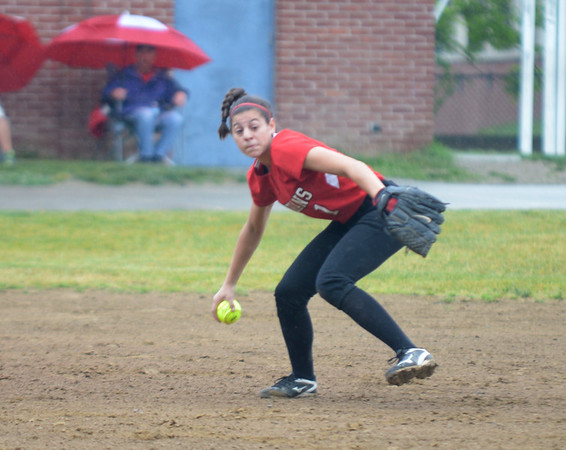 JIM VAIKNORAS/Staff photo Amesbury's Maddie Napoli makes a play against Mount Alvernia at Chris Perry Field in Amesbury Sunday. The Indian's won the game 9-2.