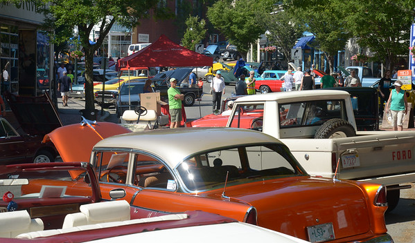 JIM VAIKNORAS/Staff photo 6/26/2016 Vintage cars fill downtown Amesbury at the Amesbury Days Car Show Sunday.