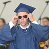 JIM VAIKNORAS/Staff photo Keegan Leary puts on a pair of sunglasses after getting him diploma at  Triton's Commencement Saturday in the school's field house.