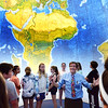 BRYAN EATON/Staff Photo. Dr. Vernon Domingo of Bridgewater State University talks to Amesbury Middle School seventh-graders inside EarthView a 20-foot high inflatable globe. The EarthView outside is a hand-painted, large-scale map of the Earth's surface, showing biological communities, rivers, seas, landforms, continents, islands, oceans, and major cities all of which Domingo touched upon.