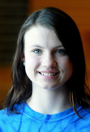 Byfield: Triton Track star Kerstin Darsney runs srprints in teh school gym. Jim Vaiknoras/staff photo