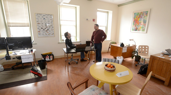 Amesbury: Ed Justen, standing,talks with Michael McAuiliffi at Workspace 36<br />  at 36 Main Street in Amesbury. Jim Vaiknoras/staff photo