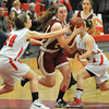 Watertown: Newburyport's Lilly Donovan drives to the basket against Watertown during the Clippers loss Saturday at Watertown High School. Jim Vaiknoras/staff photo