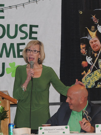 Newburyport: Ann Ormond rubs Rep. Mike Costello's bald head as she sings at the 12th annual Link house St Patrick's Day luncheon at the Mason's in Newburyport. Jim Vaiknoras/staff photo