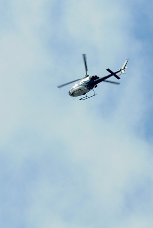 Merrimac: A helecopter searches over Winter and Church Streets in Merrimac. They are searching for a man from Maine who is missing.  Jim Vaiknoras/staff photo