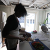 newburyport: Shiela Mullins chopping vegetables in her kitchen. Jim Vaiknoras/staff photo