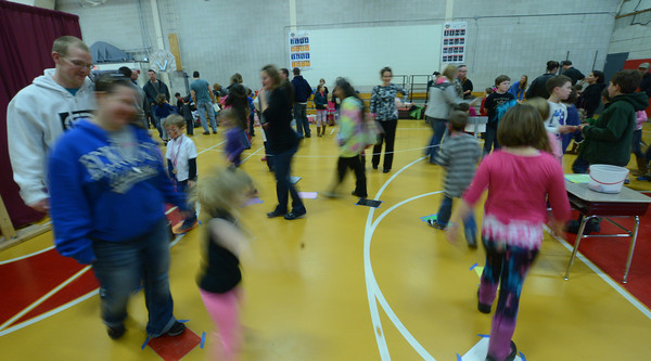 Amesbury: Kids and parents look to win confections in the Cake Walk at the Family Fun Fair at the Cashman School in Amesbury Saturday. Jim Vaiknoras/staff photo