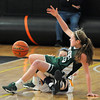 Woburn: Pentucket's McKenna Kilian tries to keep her balance after making a steal against Arlington Catholic during the Sachem's 59-35 defeat at Woburn high Saturday. Jim Vaiknoras/staff photo