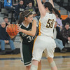 Woburn: Pentucket's Lauren Tiglione looks to pass around Arlington Catholic's Demiana Fogerty during the Sachem's 59-35 defeat at Woburn high Saturday. Jim Vaiknoras/staff photo