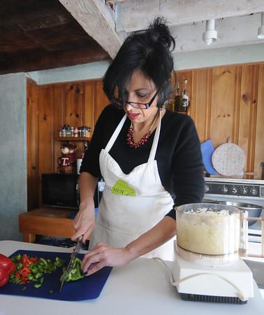 newburyport: Shiela Mullins chopping vegetables in her kitchen. Jim Vaiknoras/staff photo