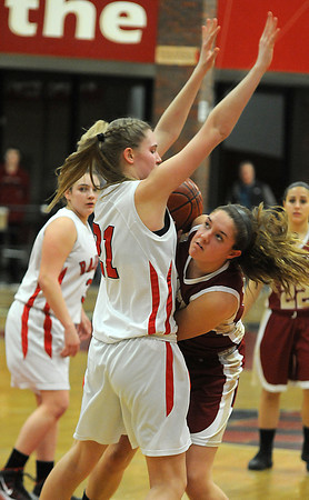 Watertown: Newburyport's Emily Pettigrew looks for her shot while being guarded by Watertown's Shannon Murphy during the Clippers loss Saturday at Watertown High School. Jim Vaiknoras/staff photo