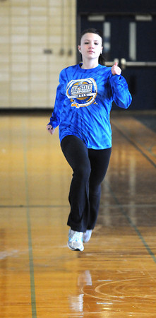 Byfield: Triton Track star Kerstin Darsney runs srprints in teh school gym. Jim Vaiknoras/staff photo
