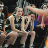 Woburn: Pentucket's Carolyn Modlish, Audrey Tipson, and   Kelsi McNamara look on as  the Sachem's fall 59-35 to Arlington Catholic at Woburn high Saturday. Jim Vaiknoras/staff photo
