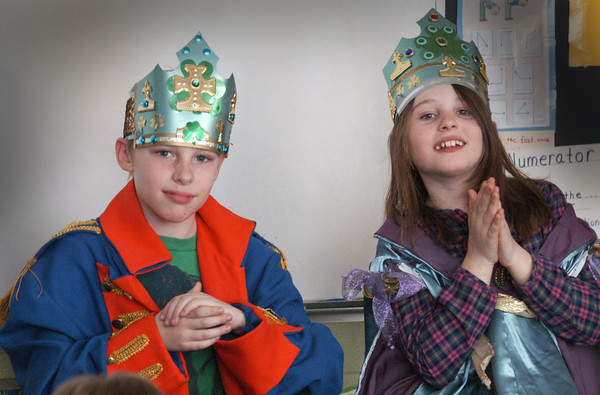 Amesbury: Tobias Evans, left, and Lauren Rivers clap to Irish music in Suzanne Morin's class at Amesbury Elementary School on Monday. The children were having a Saint Patrick's Day celebration with music and dancing and the two pictured were king and queen of the event. Bryan Eaton/Staff Photo