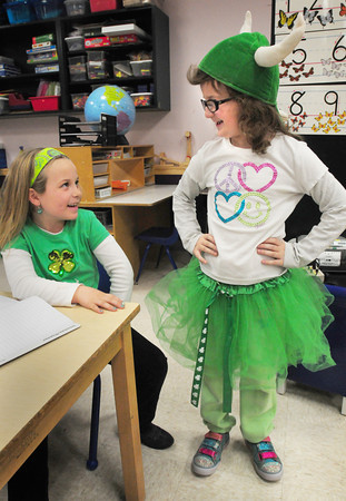 Amesbury: Addy Upson, left, and Hannah Hume, both 6. show off their Saint Patrick's Day green with Hannah wearing a green tutu. The two were in Deb Whitney's class at the Cashman School in Amesbury. Bryan Eaton/Staff Photo