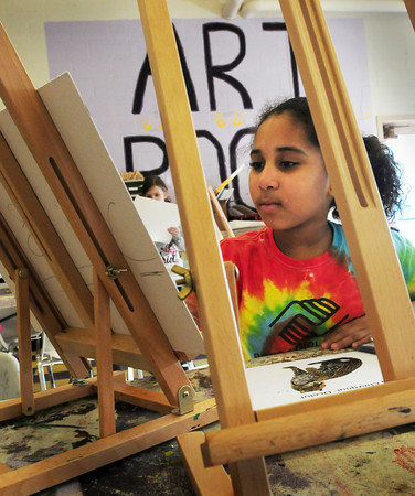 """Salisbury: Safia Cherqoui, 9, of Newburyport paints an ocelot from a photo in the art room at the Boys and Girls Club in Salisbury. She was in the girls only class """"Power of Paint"""" with counselor Kandace Demers where the talk about self esteem and other issues and then spend time painting. Bryan Eaton/Staff Photo"""