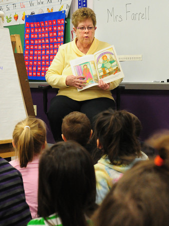"""Amesbury: Sally Morrill reads """"James O'Rourke and the Pooka"""" to a first grade class at the Cashman School in Amesbury on Monday. Morrill, who volunteers at the school, was reading for Read Across America. Bryan Eaton/Staff Photo"""