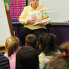 "Amesbury: Sally Morrill reads ""James O'Rourke and the Pooka"" to a first grade class at the Cashman School in Amesbury on Monday. Morrill, who volunteers at the school, was reading for Read Across America. Bryan Eaton/Staff Photo"