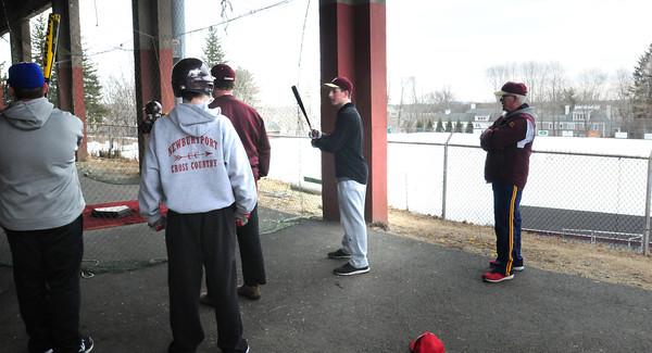 Newburyport: With their baseball field under snow, the Newburyport High baseball team took practice under the football field stands. Bryan Eaton/Staff Photo
