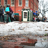 Newburyport: The last pile of snow melts in Newburyport's Market Square as temperatures hit into the 40's on Friday. The weekend rain should finish the job as well as helping to melt other piles of snow in the area. Bryan Eaton/Staff Photo