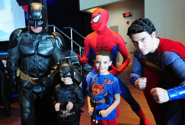 """Salisbury: Cole Moniz, 4, left, of Tewksbury and his brother Dante, 7, pose with Batman, Spiderman and Superman at a Super Heroes Brunch at the Pavilion at Salisbury Beach on Sunday. The three actors who portray the heroes host different charity events including appearances at Children's Hospital in Boston and presented Cole, who has leukemia, with a special goody bag and """"deputized"""" him for the day. Bryan Eaton/Staff Photo"""