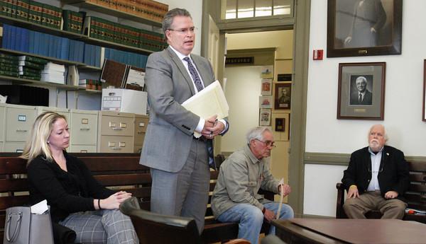 Newburyport: Allison Heartquist's attorney John Clifford addresses the board of registrars as she, left, and Michael Ferrick, far right, listen. Bryan Eaton/Staff Photo