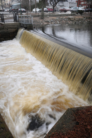 Amesbury: Heavy rains yesterday raised the level of the Powow River seen flowing over the dam in Amesbury's Upper Millyard yesterday morning, creating an eddy seen at bottom of photo. Bryan Eaton/Staff Photo