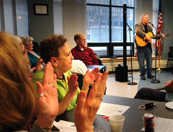 Amesbury: Brian Corcoran gets hands clapping with his Irish music on Wednesday afternoon. He was at the Amesbury Council on Aging where they were celebrating St. Patrick's Day a little early. Bryan Eaton/Staff Photo