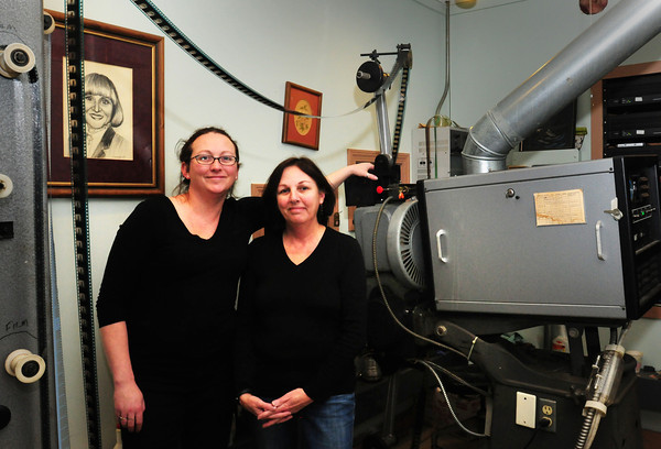 Amesbury: Shannon Turbity, left, and her mother, Donna, are raising money to outfit their Stage Two Cinema Pub with a digital projector to replace the film projector, right. Movie distributors are going to discontinue movies on film Bryan Eaton/Staff Photo