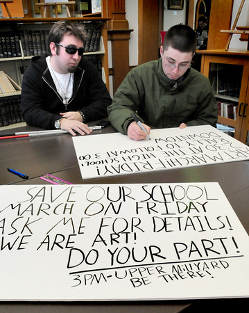 Amesbury: Organizers of Friday's Save the Soul of Amesbury's Schools rally make signs, Cody Care, left, and Andrew Kooken. Bryan Eaton/Staff Photo