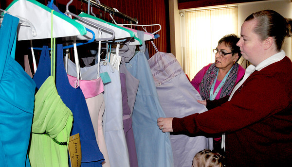 Newburyport: Donna Sylvester, left, and Meghan Brunelle of the Salvation Army are collecting gently used prom dresses for an event they'll be hosting  in May. Bryan Eaton/Staff Photo