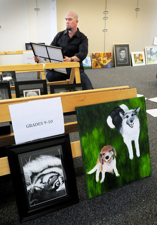 Newburyport: AJ Smith judges entries for the Young and Budding Artists Show at the Newburyport Art Association. Bryan Eaton/Staff Photo