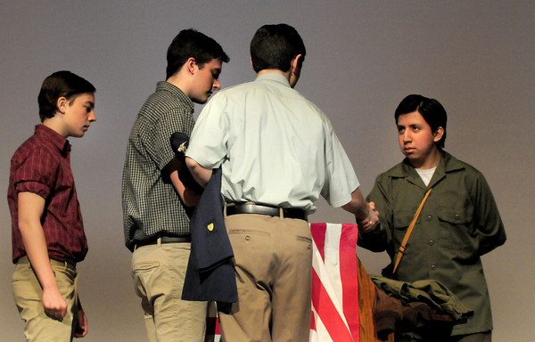 Amesbury: Amesbury High School students act out a scene of their predecessors lining up to sign up to fight in World War II. Bryan Eaton/Staff Photo