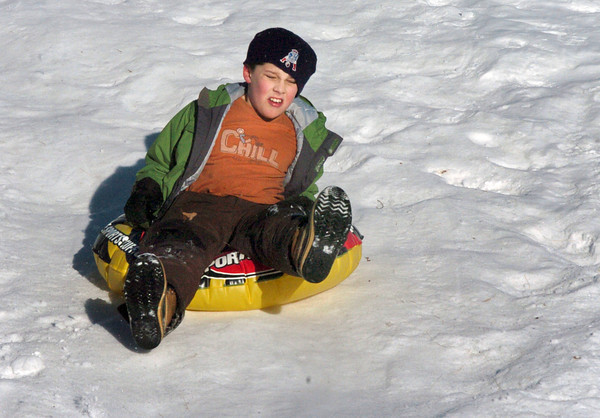 Newburyport: Austin Hyer, 9, hits the bottom of the hill hard at the Bartlet Mall on Thursday afternoon. He and others from the YWCA's School's Out Program were sledding and skating there. Bryan Eaton/Staff Photo