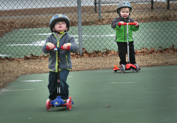 Newburyport: Jake Gouette, 3, of Hampstead, N.H. and Jack Marino, 2, of Bradford move along at the tennis courts at Cashman Park this weekend. The two were there with their parents who come to Newburyport often and like to go to Agave Mexico Bistro. Bryan Eaton/Staff Photo