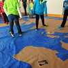 Salisbury: Students in Salisbury Elementary School's Kid's Club participate in the program Change Is Simple which teaches children about environmental responsibililty. Here they post pictures of endangered species in the country of their origin on a giant map of the world. Later they were taught about water recycling and conservation. Bryan Eaton/Staff Photo