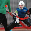 Salisbury: James Tatro of the Sabres looks for the ball before making a save against the Cunnucks in a game of floor hockey at Salisbury Elementary School on Monday. The games, on Monday and Tuesdays, are one of several afterschool activities. Bryan Eaton/Staff Photo