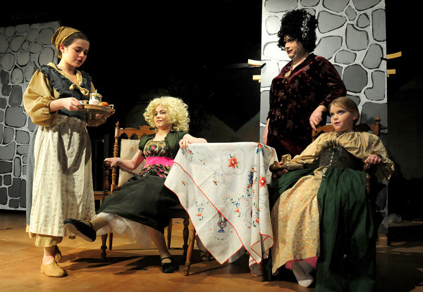 "Amesbury: Cinderalla, left, played by Miya Gakidis gets tripped by Samantha Currier, as Derek Balaam, Cinderella's mother, and other ""sister"" Peyton Searles look on. Bryan Eaton/Staff Photo"