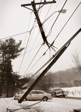 Amesbury: With temperatures in the 50's on Tuesday and snow again yesterday, nature has been teasing us with extremes as of late. Yesterday's snow brought several police calls of cars off the road in the area including this one that hit a utility pole on Whitehall Road in Amesbury. Bryan Eaton/Staff Photo
