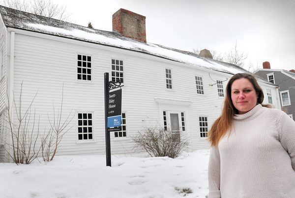 Newbury: Bethany Groff of Historic New England in front of the 344-year-old Swett-Ilsey House at 4 High Road in Newbury. The organization is seeking funding to repair the roof and chimney for the structure, believed to be one of the oldest surviving homes in the region. Bryan Eaton/Staff Photo