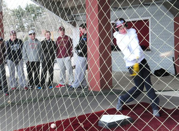 Newburyport: Newburyport baseball player Evan Trego swings in the batting cage as spring sports gets underway. Bryan Eaton/Staff Photo