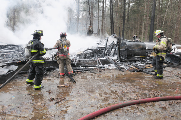 Georgetown: Firefighters responded to a 30 by 30 barn at 12 Charles Street in Georgetown that was fully engulfed in flames when they arrived. Bryan Eaton/Staff Photo