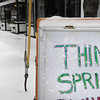 "Amesbury: A businesses signs says ""Think Spring"" but it was anything but spring in downtown Amesbury on Thursday morning as over two inches of powdery snow fell. It warms to 50 degrees on Saturday and then gets colder again at the beginning of the week. Bryan Eaton/Staff Photo"