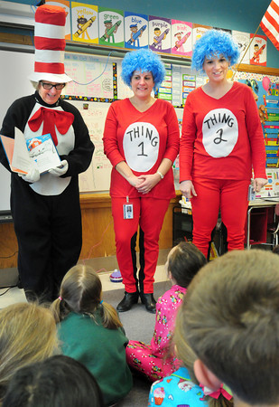 Newbury: Schools in the area celebrated Read Across America bringing in guest readers to celebrate Dr. Seuss's birthday Monday. Staff at Newbury Elementary School really got into the spirit dressing up as Seuss characters, from left, reading specialist Margo Ryan as the Cat in the Hat, principal Beth Yando as Thing 1 and vice principal Amy Pasquarello as Thing 2. Bryan Eaton/Staff Photo