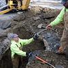 PAUL BILODEAU/Staff photo. Water Dept. workers in Newburyport work to repair a break on Liberty Street yesterday.