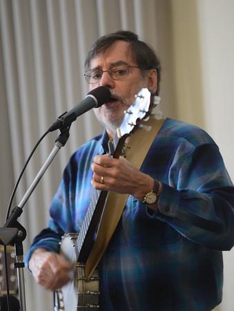 JIM VAIKNORAS/Staff photo Roger Tincknell sings sea shanties at the Rowley Library Saturday morning.