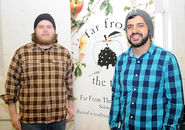 "JIM VAIKNORAS/Staff photo Noel McInnes and Antonio Fresco of ""Far From the Tree Cider""  in Salem Amesbury beer fest Saturday."