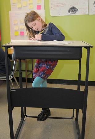 JIM VAIKNORAS/Staff photo Elizabeth Boelke, 9, uses a standing desk at the Molin Upper Elementary School.