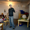 "BRYAN EATON/Staff Photo. Paper cut artist Dylan Metrano, a Newburyport native, now living in Maine, gave a presentation on his children's book ""Everyday Birds"" to youngsters at the Newburyport Montessori School. He then showed a time lapse video of how he makes his paper cut-outs."